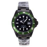 Replique Rolex Submariner automatique pvd complète avec cadran noir et lunette verte 17605